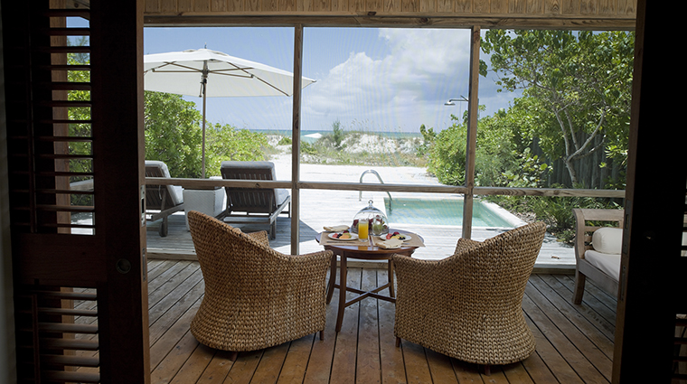 Property COMOParrotCay Hotel GuestroomSuite OneBedroomBeachHouseTerrace COMOHotelsandResorts