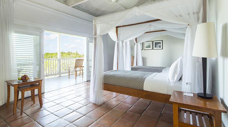 Property COMOParrotCay Hotel GuestroomSuite TerraceOceanGardenRoom COMOHotelsandResorts