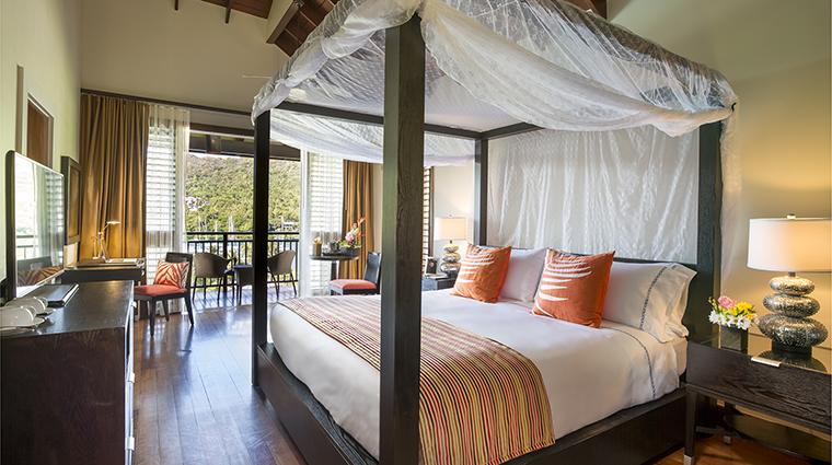 Property CapellaMarigotBay Hotel GuestroomSuite OneBedroomResortViewSuiteBedroom CapellaHotelsandResorts