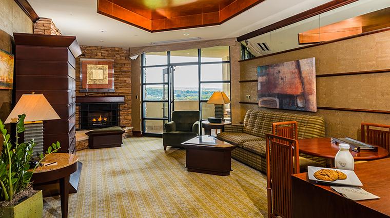 Property FallingRockatNemacolinWoodlandsResort Hotel GuestroomSuite SuiteLivingRoom NemacolinWoodlandsResort