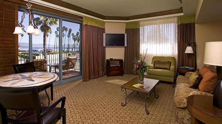 Property HarborViewInn 9 Hotel GuestroomSuite LuxuryOceanViewSuite LivingRoom CreditHarborViewInn