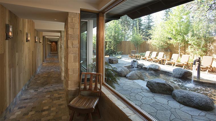 Property TheCoveSpa Spa 3 Style SpaHallwayWithAViewToThePool CreditShoreLodege
