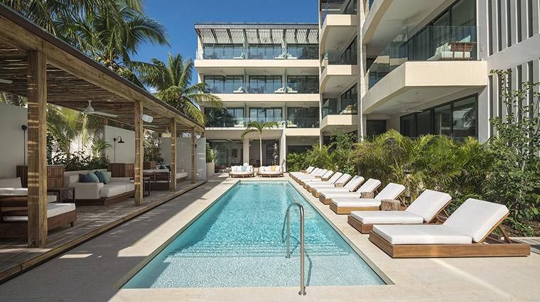 Property ThompsonPlayadelCarmen Hotel PublicSpaces BeachHouseExterior&Pool ThompsonHotels