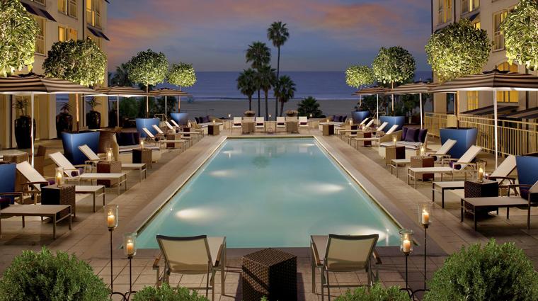 PropertyImage LoewsSantaMonicaBeachHotel 1 Hotel Exterior PoolAtNight CreditLoewsHotels