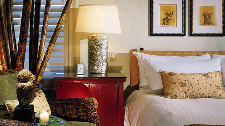 PropertyImage TradewindsCarmel Hotel GuestroomSuite DeluxeKingRoom BedDetail CreditTradewinds