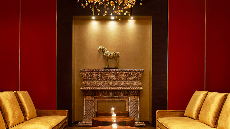 The st regis doha remede vintage bar fireplace