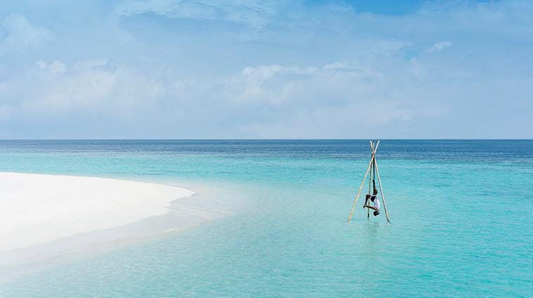 anantara kihavah maldives villas aerial overwater yoga