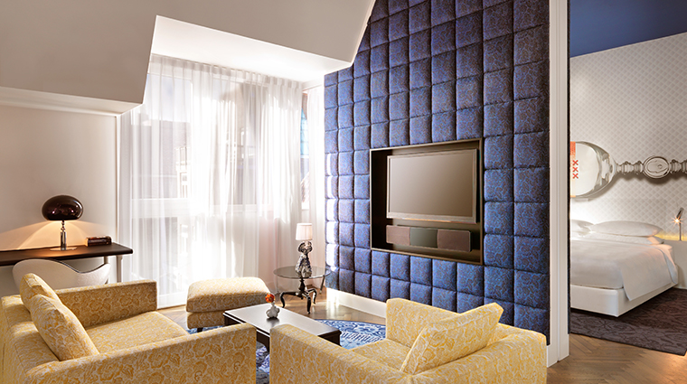 andaz amsterdam prinsengracht suite bed and living room