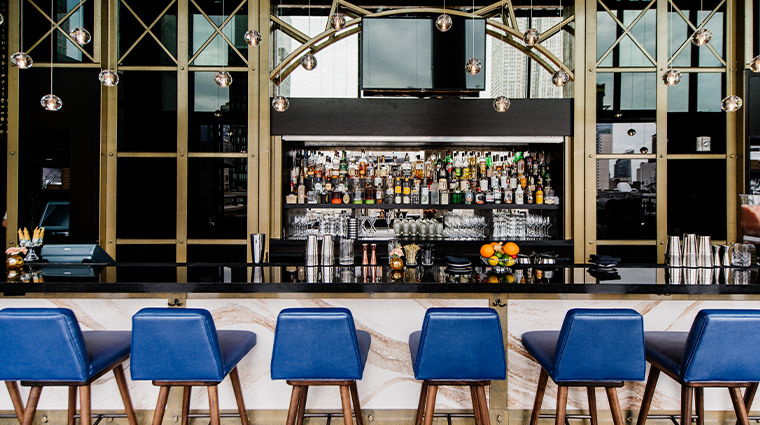 archer hotel new york spyglass bar and stools