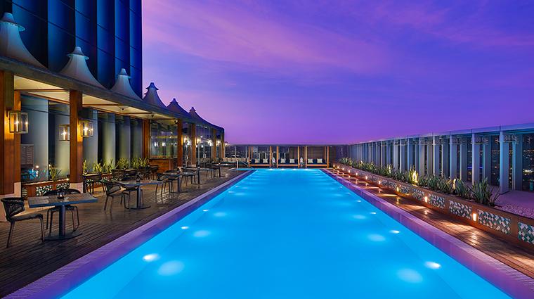 assila hotel swimming pool night