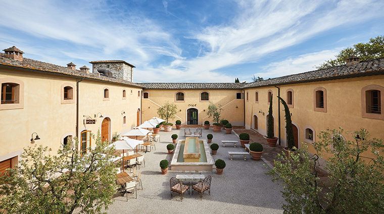 belmond castello di casole courtyard day