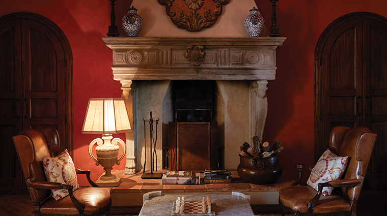 belmond castello di casole fireplace