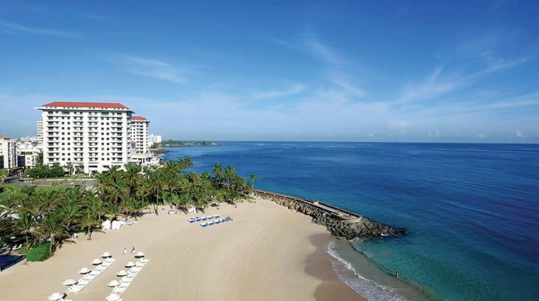 condado vanderbilt hotel aerial with beach wide