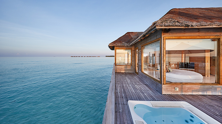 conrad maldives rangali island sunset water villa pool deck day
