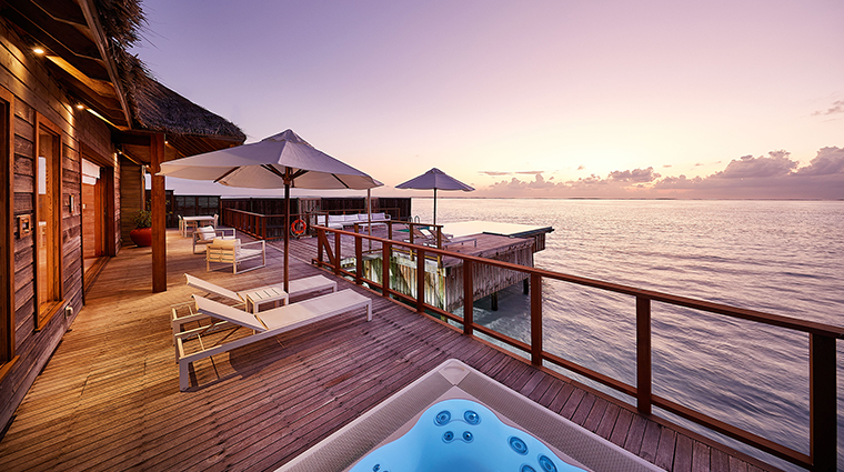 conrad maldives rangali island sunset water villa pool deck dusk
