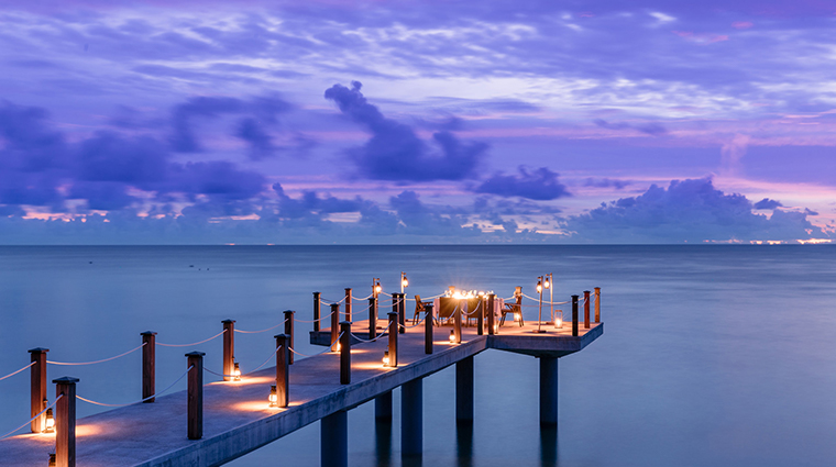 four seasons resort seychelles at desroches island dock night
