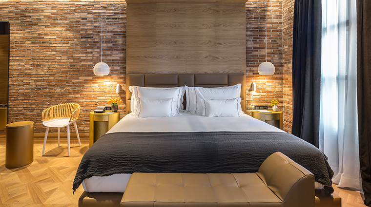 monument hotel deluxe bed