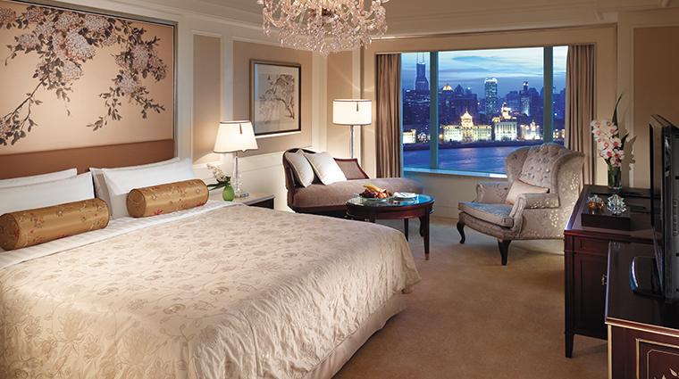 pudong shangri la east shanghai suite bedroom night
