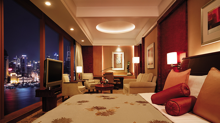 pudong shangri la east shanghai suite bedroom view night