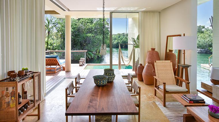 rosewood mayakoba deluxe overwater lagoon suite living room view