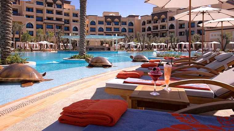 saadiyat rotana resort and villas pool loungers