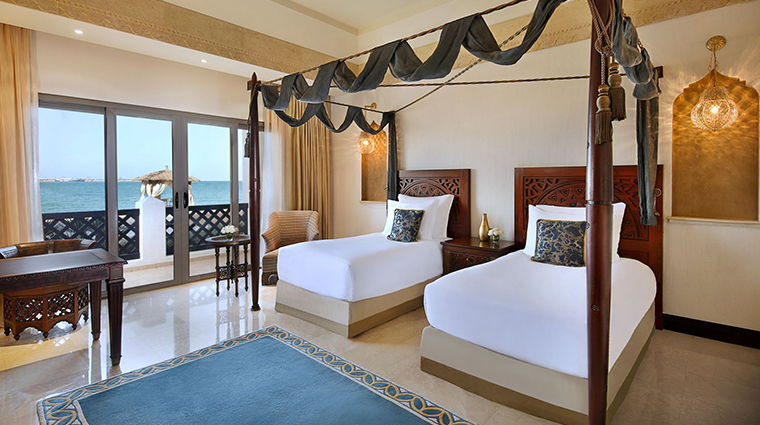 sharq village spa twin bedroom
