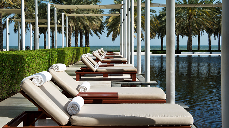 the chedi muscat pool loungers