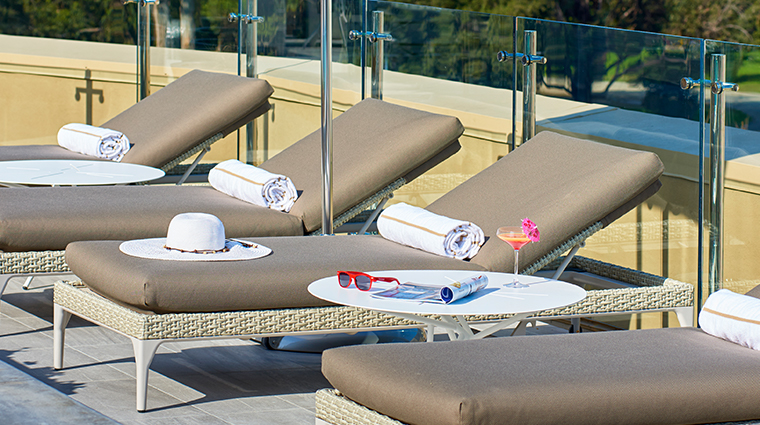 the clement hotel rooftop pool lounge chairs