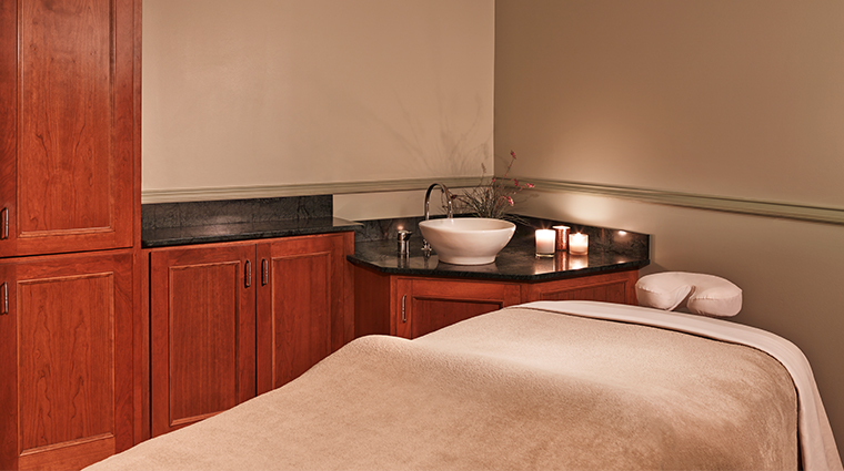 the equinox a luxury collection golf resort spa treatment room