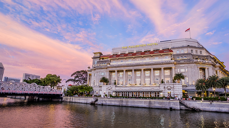 the fullerton hotel singapore exterior sunset