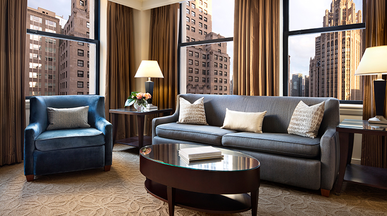 the gwen a luxury collection hotel suite living room view