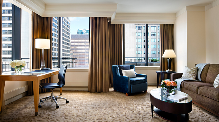 the gwen a luxury collection hotel suite living room wide