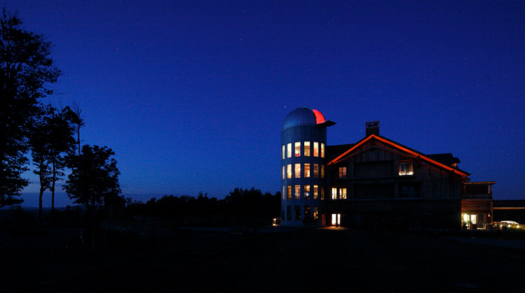 the lodge and cottages at primland observatory night