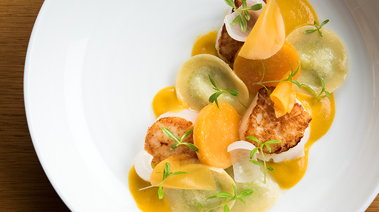 the modern scallop with pumpkin and tarragon ravioli