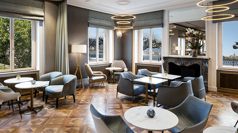the ritz carlton hotel de la paix geneva living room bar and kitchen view