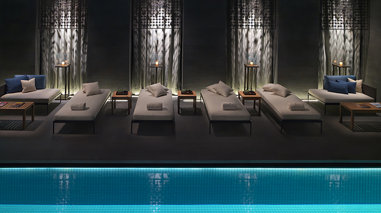 the spa at mandarin oriental milan pool lounging chairs